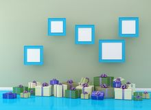 Christmas and New Year concept picture frame with gift box set o. N blue room interior background. for copy space and website. minimal concept.  Merry Christmas Royalty Free Stock Image