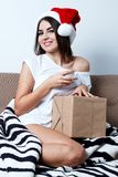 Christmas New Year Concept, sexy model in santa hat with present. S, cute girl with gift Stock Images