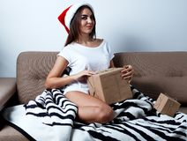 Christmas New Year Concept, sexy model in santa hat with present Royalty Free Stock Images