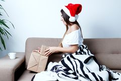 Christmas New Year Concept, sexy model in santa hat with present. S, cute girl with gift Stock Image