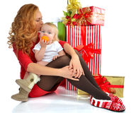 Christmas new year concept woman infant child baby presents Stock Photos