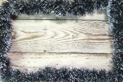 Christmas and New Year Concept. wooden board in a frame tinsel, garland, Top view, flat lay royalty free stock photos