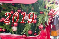 2019 Christmas and new year concepts,An opened red car trunk filled with cloth bags full of gifts and decorations for stock images