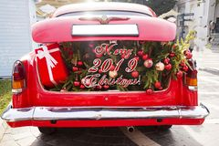 2019 Christmas and new year concepts,An opened red car trunk filled with cloth bags full of gifts and decorations for stock photo