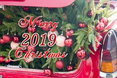 2019 Christmas and new year concepts,An opened red car trunk filled with cloth bags full of gifts and decorations for stock photos