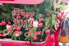 2019 Christmas and new year concepts,An opened red car trunk filled with cloth bags full of gifts and decorations for royalty free stock images