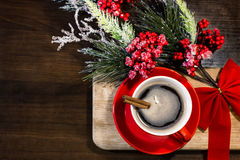 Christmas and New Year cup of coffee with cinnamon on wooden background with decorations Stock Photography