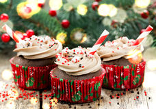 Christmas and New Year cupcakes - chocolate cakes with cream, sp Stock Images