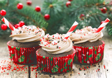 Christmas and New Year cupcakes - chocolate cakes with cream, sp Stock Image