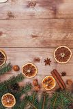 Christmas or New Year brown wooden background, Christmas food decor with fir tree.Xmas decorations, space for a text. Christmas or New Year dark wooden Stock Photos