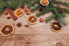 Christmas or New Year brown wooden background, Christmas food decor with fir tree.Xmas decorations, space for a text. Christmas or New Year dark wooden Royalty Free Stock Photography