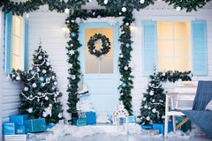 Christmas and New Year decorated interior room with presents and New year tree stock images