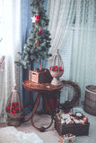 Christmas and New Year decorated interior room with presents and. New year tree .Old children toys on wooden background for christmas decoration Royalty Free Stock Photo