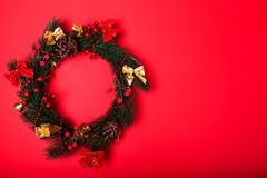 Christmas and New Year wreath on red background. Space. Christmas and New Year decorated wreath on red background. Space stock images