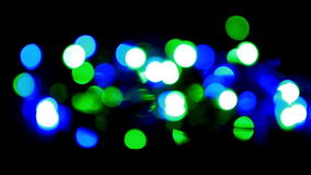 Christmas and new year decoration. Abstract. Blurred bokeh blinking garland. Holiday background Christmas tree lights twinkling stock video footage