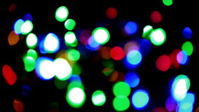 Christmas and new year decoration. Abstract. Blurred bokeh blinking garland. Holiday background Christmas tree lights twinkling stock video