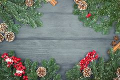 Christmas or New Year decoration background with fir branches on. Wooden  background Royalty Free Stock Images