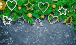 Christmas or New Year decoration background: fur-tree branches, colorful glass balls on black grunge background with copy space to royalty free stock images