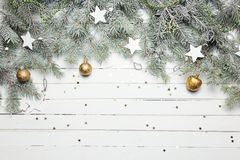 Christmas or New Year decoration background: fur-tree branches, colorful glass balls and glittering stars on white Stock Photo