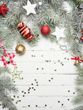 Christmas or New Year decoration background: fur-tree branches, colorful glass balls and glittering stars on white Stock Photos