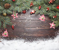 Christmas or New Year decoration background: fur-tree branches, colorful glass balls and glittering stars on wooden Royalty Free Stock Photography
