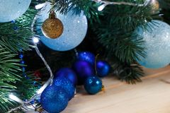 Christmas or New Year decoration background: fur-tree branches, colorful glass balls on wooden background royalty free stock images