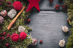 Christmas or New Year decoration background: moss, berries, star Royalty Free Stock Image