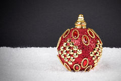 Christmas or New Year decoration background: red x-mas ball on s Stock Images