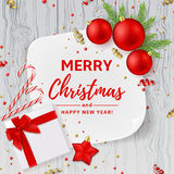 Christmas or New Year decoration background. Vector illustration. Top view on Xmas composition with gift box, golden confetti and red balls. Festive backdrop Royalty Free Stock Image
