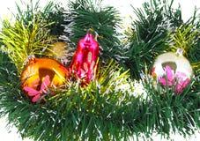 Christmas,New Year decoration-balls, green tinsel Royalty Free Stock Image