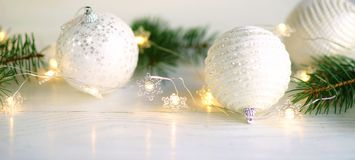 Christmas and New Year decoration.banner. Christmas and New Year decoration. Christmas white silber balls, tree, candle, bokeh on white background, soft focus Stock Images