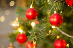 Christmas and New Year Decoration. Bauble on Christmas Tree. Abstract christmas background with defocused lights Royalty Free Stock Photography