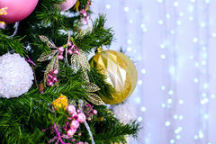 Christmas and New Year Decoration. Bauble on Christmas Tree. Abstract christmas background with defocused lights Stock Photography
