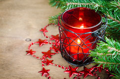 Christmas New Year decoration. Burning candle, xmas tree and garland. Selective focus. Royalty Free Stock Photo