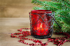 Christmas New Year decoration. Burning candle, xmas tree and garland. Selective focus. Stock Photography