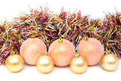 Christmas, New Year decoration composition, pink and gold balls with multicolored tinsel Stock Photo