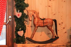Christmas and New Year decoration decorative wooden rocking horse  toy in retro style Stock Photo