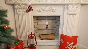Christmas New Year decoration by the fireplace stock video footage