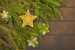 Christmas or New Year decoration with golden star on green fir tree with copy space. Christmas or New Year decoration with golden star on green fir tree over royalty free stock photo