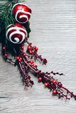 Christmas and New year decoration. Green fir tree branch with red berries. Red lollypops, white chocolate glaze. Traditional sweets on wooden table. Photo for royalty free stock photo