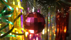 Christmas and new year decoration. Hanging Bauble close. Christmas Lights Twinkle In The Tree. Christmas and New Year Decoration. Hanging Bauble close up stock video footage