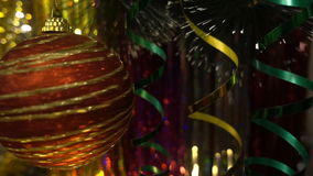 Christmas and new year decoration. Hanging Bauble close. Christmas Lights Twinkle In The Tree. Christmas and New Year Decoration. Hanging Bauble close up stock footage