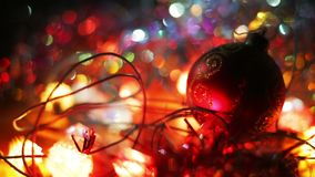 Christmas and New Year Decoration. Hanging Bauble close up. Abstract Blurred Bokeh Holiday Background. Blinking Garland stock footage