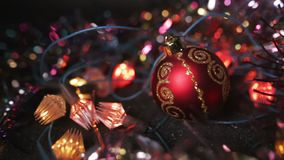 Christmas and New Year Decoration. Hanging Bauble close up. Abstract Blurred Bokeh Holiday Background. Blinking Garland. Christmas Tree Lights Twinkling stock video