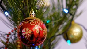 Christmas and New Year Decoration. Hanging Bauble close up. Abstract Blurred Bokeh Holiday Background. Blinking Garland. Christmas Tree Lights Twinkling stock footage