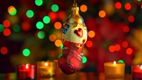 Christmas and New Year Decoration with Lights. Christmas and New Year Decoration Toy with  Tree Lights Twinkling close up stock video