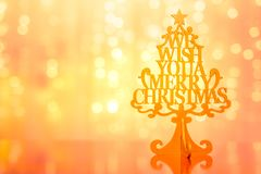 Christmas tree on golden blurred background, Xmas concept stock photo