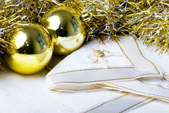 Christmas New Year decoration ornament  balls. Shiny Shiny color Christmas New Year decoration ornament balls with textured fabric napkins on a table Stock Images