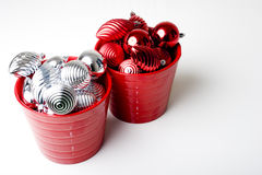 Christmas New Year decoration ornaments. Bunch Christmas New Year red and silver decoration ornaments in two red baskets Royalty Free Stock Image
