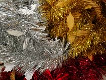 Christmas and New year decoration, red silver and gold tinsel. Background Royalty Free Stock Photos
